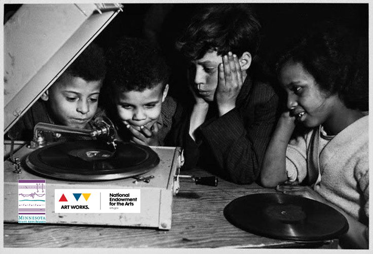 4 kids around a record player